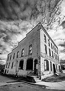 Abandoned Reidsville Grocery building, with dramatic clouds.