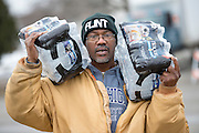 FLINT, MICHIGAN, USA - JANUARY 23: Flint, Michigan resident Steve Deloney carries water which he was using for himself and delivering to his sister Saturday, January 23, 2016 outside a water distribution location at Flint Fire Station Number 3 in Flint, Michigan. (Photo by Bryan Mitchell)