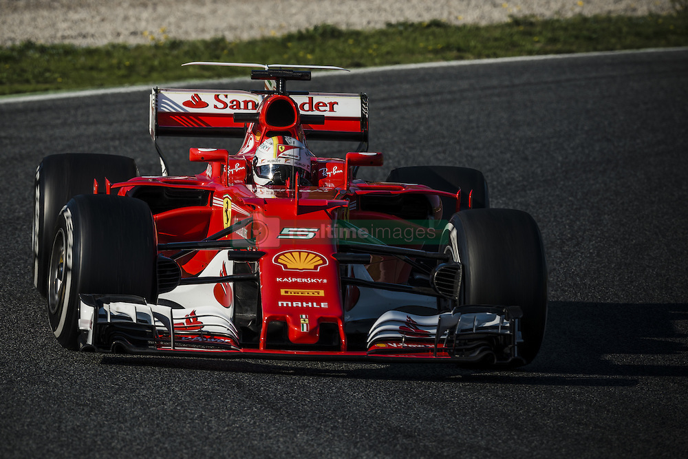 February 27, 2017 - SEBASTIAN VETTEL (GER) drives in his Ferrari SF70H on the track during day 1 of Formula One testing at Circuit de Catalunya, Spain (Credit Image: © Matthias Oesterle via ZUMA Wire)