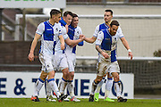 Bristol Rovers Midfielder, Ollie Clarke (8) heads in the opening goal 1-0 Bristol Rovers Players Celebrate during the EFL Sky Bet League 1 match between Bristol Rovers and Scunthorpe United at the Memorial Stadium, Bristol, England on 25 February 2017. Photo by Adam Rivers.