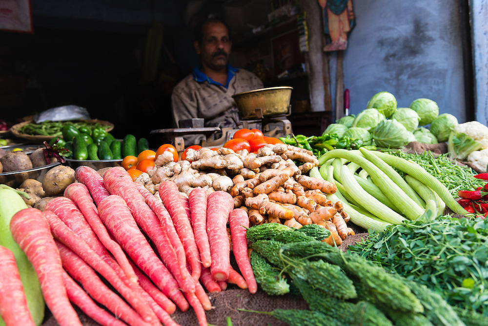 Man selling vegetables in shop in blue city of Jodhpur