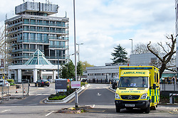 © Licensed to London News Pictures. 13/03/2020. Slough, UK. An ambulance at an entrance to Wexham Park Hospital. Staff at a hospital in Berkshire have tested positive for the COVID-19 coronavirus after a patient was also diagnosed. The elderly care ward at Wexham Park Hospital in Slough has been temporarily closed to new admissions for two weeks. Frimley Health NHS Foundation Trust said staff affected are self-isolating. Photo credit: Peter Manning/LNP
