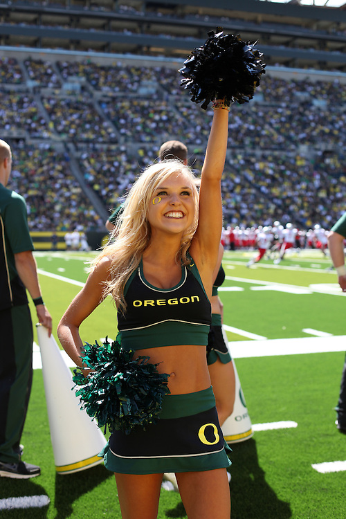 EUGENE, OR - SEPTEMBER 4:  A cheerleader of the Oregon Ducks cheers against the New Mexico Lobos at Autzen Stadium on September 4, 2010 in Eugene, Oregon. The Ducks defeated the Lobos 72-0.  Photo by Tom Hauck.
