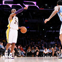 23 November 2014: Los Angeles Lakers guard Kobe Bryant (24) brings the ball up court during the Los Angeles Lakers season game versus the Denver Nuggets, at the Staples Center, Los Angeles, California, USA.