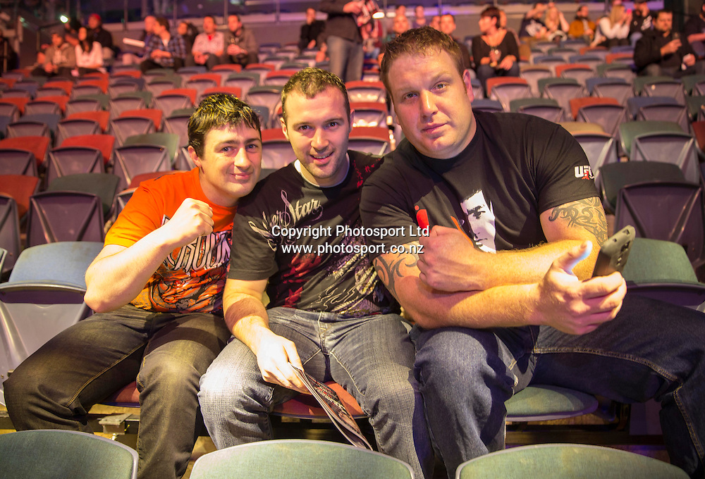 Fans from left; Ryan Smith, Jeremy Smith and Ryan Fitzpatrick from Palmerston North enjoy the atmosphere at Vector Arena, Auckland during the UFC Ultimate Fighting Championship fight night held on Saturday 28th of July 2014. <br /> Credit; Peter Meecham/ www.photosport.co.nz