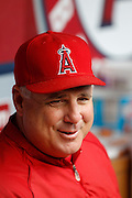 ANAHEIM, CA - JUNE 03:  Mike Scioscia (14) of the Los Angeles Angels of Anaheim laughs as he talks to the media before the game against the Texas Rangers on Sunday, June 3, 2012 at Angel Stadium in Anaheim, California. The Rangers won the game 7-3. (Photo by Paul Spinelli/MLB Photos via Getty Images) *** Local Caption *** Mike Scioscia