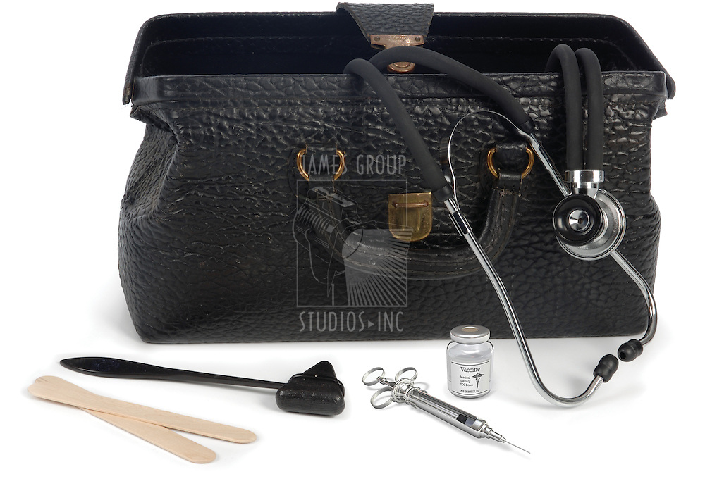 Open medical bag with medical instruments on white background