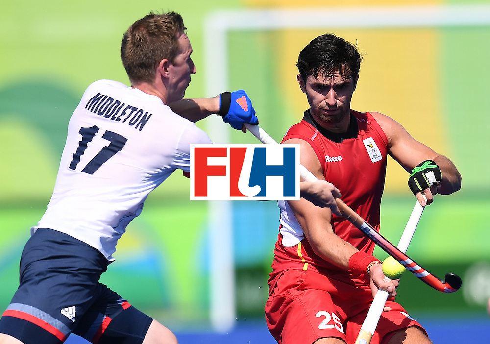 Britain's Barry Middleton fights for the ball with Belgium's Loick Luypaert during the men's field hockey Belgium vs Britain match of the Rio 2016 Olympics Games at the Olympic Hockey Centre in Rio de Janeiro on August, 6 2016. / AFP / MANAN VATSYAYANA        (Photo credit should read MANAN VATSYAYANA/AFP/Getty Images)