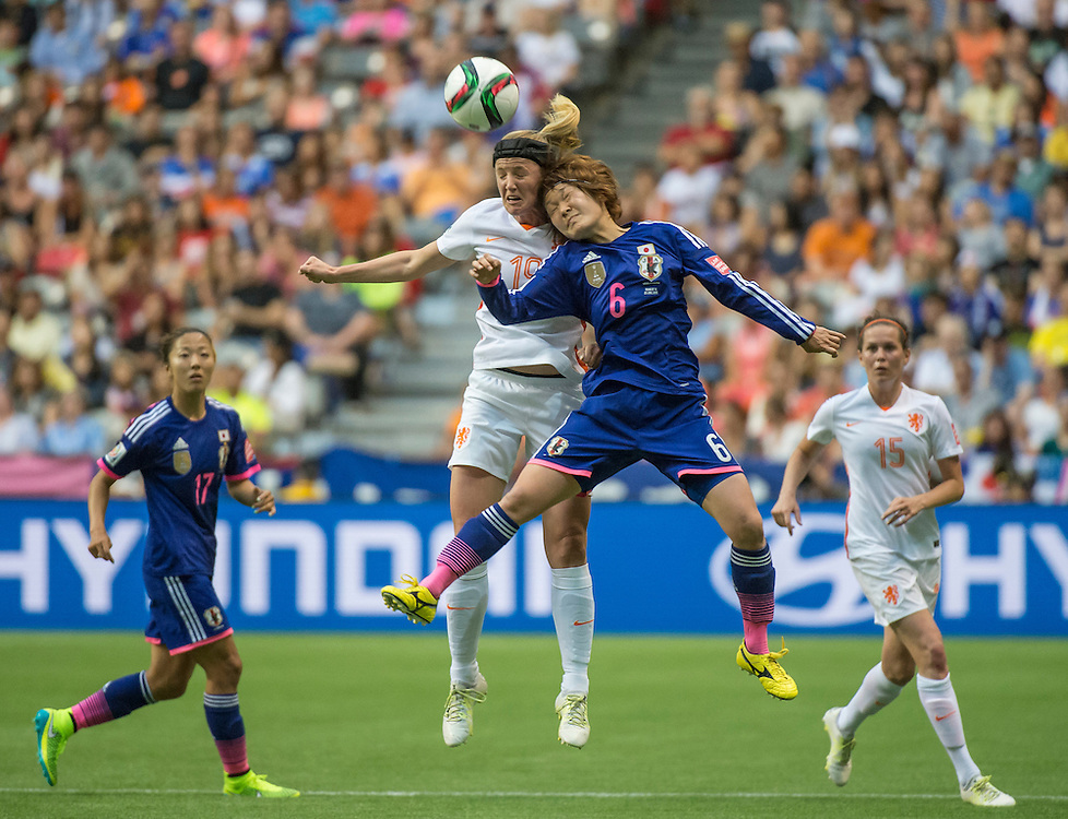 Kirsten Van De Ven of team Netherlands (left) and Mizuho Sakaguchi of team Japan in 2015 women's World Cup Soccer in Vancouver during second round action between Japan and the Netherlands.