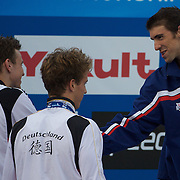 Paul Biedermann of Germany, who won the silver medal in the Men's 4x 100m Medley relay event, shakes hands with Michael Phelps of USA who won gold at the World Swimming Championships in Rome, Italy on Sunday, August 2, 2009. Photo Tim Clayton...