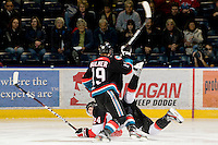 KELOWNA, CANADA, DECEMBER 3: Brett Bulmer #19 of the Kelowna Rockets checks Michael Mylchreest #24 of the Prince George Cougars as the Prince George Cougars visit the Kelowna Rockets  on December 3, 2011 at Prospera Place in Kelowna, British Columbia, Canada (Photo by Marissa Baecker/Shoot the Breeze) *** Local Caption ***