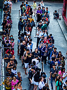 24 JANUARY 2019 - BANGKOK, THAILAND:  Hundreds of people wait in line to go to the first Taco Bell in Thailand. The Taco Bell  opened Thursday. The restaurant has a 215 square meter space in the Mercury Ville, a mixed use retail/office building in central Bangkok. Taco Bell is owned by Yum Brands, which also owns KFC, Pizza Hut, and WingStreet. Taco Bell in Thailand joins KFC, which has more than 500 restaurants in Thailand and Pizza Hut, which recently started expanding in Thailand.   PHOTO BY JACK KURTZ