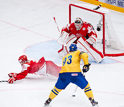 07.05.2012, Ericsson Globe, Stockholm, SWE, IIHF, Eishockey WM, Schweden vs Daenemark, im Bild Sverige Sweden 93 Johan Franzen shoots against Denmark 30 Goalkeeper Frederik Andersen (Fr?lunda), Denmark 5 Daniel Nilsen (Hamburg Freezers) // during the IIHF Icehockey World Championship Game between Sweden vs Danmark at the Ericsson Globe, Stockholm, Sweden on 2012/05/07. EXPA Pictures © 2012, PhotoCredit: EXPA/ PicAgency Skycam/ ATTENTION - OUT OF SWE *****