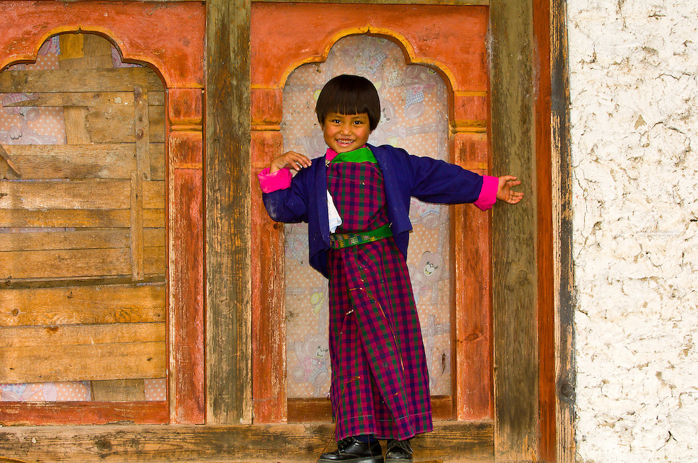 Smiling School girl wearing a kira (native costume), Bumthang Valley, Bhutan