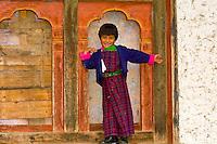 Smiling School girl wearing a kira (native costume), Bumthang Valley, Bhutan