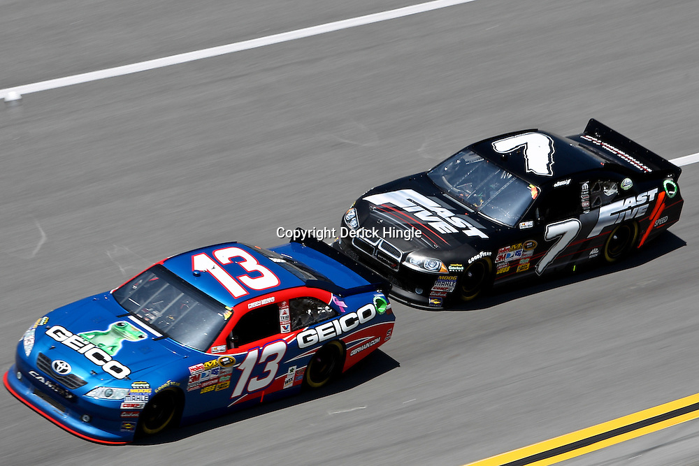 April 17, 2011; Talladega, AL, USA; NASCAR Sprint Cup Series driver Casey Mears (13) leads Robby Gordon (7) during the Aarons 499 at Talladega Superspeedway.   Mandatory Credit: Derick E. Hingle