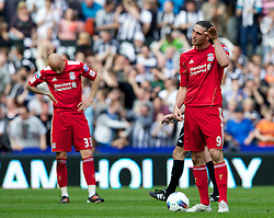 NEWCASTLE-UPON-TYNE, ENGLAND - Sunday, April 1, 2012: Liverpool's Andy Carroll and Jonjo Shelvey look dejected as Newcastle United score their second goal during the Premiership match at St James' Park. (Pic by Vegard Grott/Propaganda)