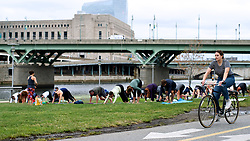 A yoga class has set up shop on the Schuylkill River banks.