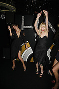 Milla Jovavich and Carmen Hawks, MILLA JOVOVICH, CARMEN HAWK & HARVEY NICHOLS CELEBRATE THE LAUNCH OF JOVOVICH-HAWK. FIFTH FLOOR CAFƒ. HARVEY NICHOLS. london.  27 April 2006. ONE TIME USE ONLY - DO NOT ARCHIVE  © Copyright Photograph by Dafydd Jones 66 Stockwell Park Rd. London SW9 0DA Tel 020 7733 0108 www.dafjones.com