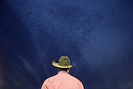Augusta, New Jersey - A cowboy watches the team penning competition at the New Jersey State Fair and Sussex County Farm and Horse Show on Aug. 11, 2010.