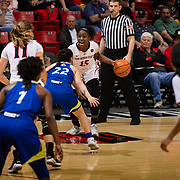 24 February 2018: The San Diego State women's basketball team closes out it's home schedule of the regular season Saturday afternoon against San Jose State. San Diego State Aztecs guard McKynzie Fort (15) yells out a play while controlling the ball in the first half.  At halftime the Aztecs lead the Spartans 36-33 at Viejas Arena.<br /> More game action at sdsuaztecphotos.com
