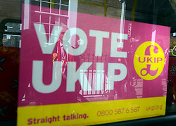 © Licensed to London News Pictures. 26/04/2012. London, UK . A man wearing a Union Flag tie is reflected in a campaign poster. The UK Independence Party (UKIP) local election campaign launch at St Stephen's Club, Central London. Photo credit : Stephen Simpson/LNP