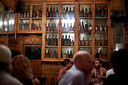 Absinthe  drinking in the 200 year old Marsella Bar, Barcelona
