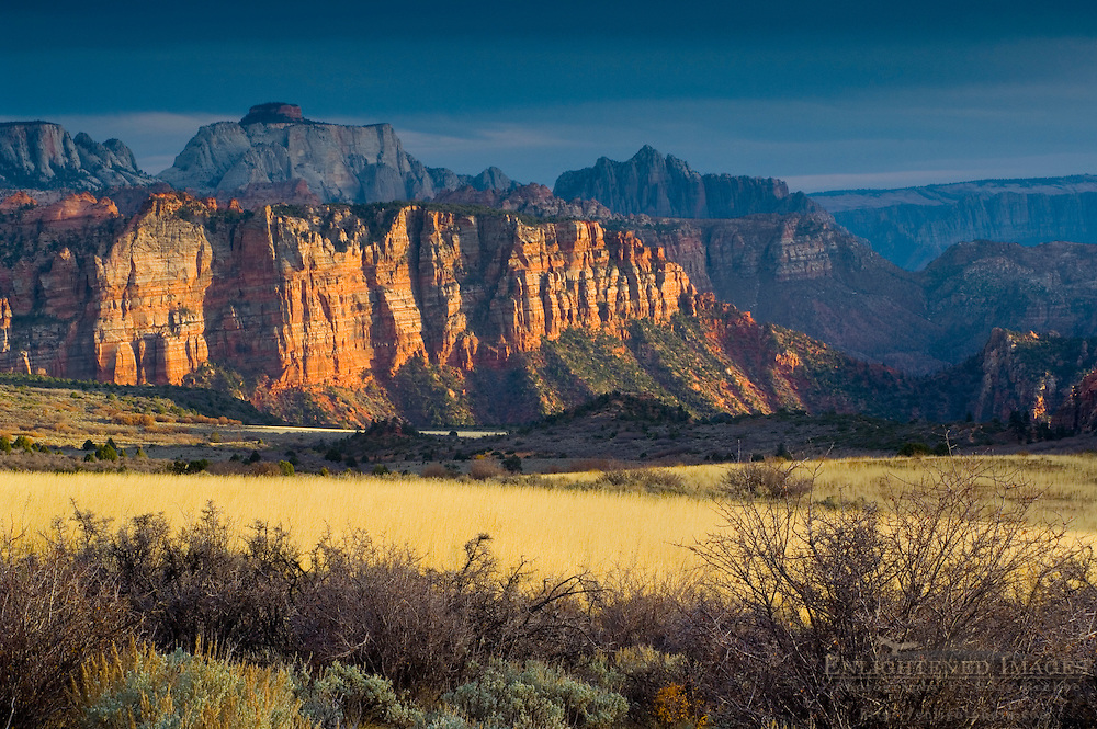 Sunset light through storm clouds on red rock cliffs near Lee Valley, Kolob Section, Zion National Park, Utah