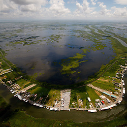 The small town of Delacroix, Louisiana, U.S., is seen from the air during a U.S. Coast Guard overflight in a C-144 aircraft on Monday, July 26, 2010. Photographer: Derick E. Hingle/Bloomberg