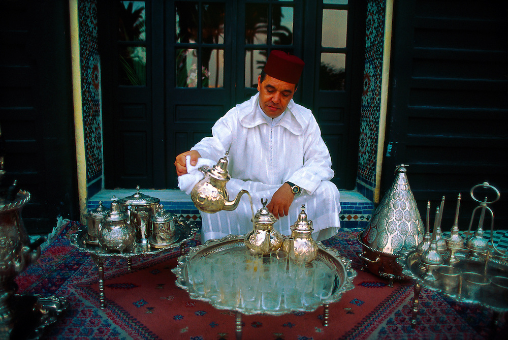 "Moroccan man serving mint tea at the ""Al Fassia"" restaurant in the Palais Jamai, Fes, Morocco"