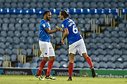 Portsmouth Defender, Christian Burgess (6) celebrates after scoring a goal to make it 1-0 during the Carabao Cup match between Portsmouth and AFC Wimbledon at Fratton Park, Portsmouth, England on 14 August 2018.