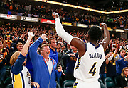 INDIANAPOLIS, IN - DECEMBER 10: Victor Oladipo #4 of the Indiana Pacers celebrates with fans after defeating the Denver Nuggets at Bankers Life Fieldhouse on December 10, 2017 in Indianapolis, Indiana. NOTE TO USER: User expressly acknowledges and agrees that, by downloading and or using this photograph, User is consenting to the terms and conditions of the Getty Images License Agreement. (Photo by Michael Hickey/Getty Images) *** Local Caption *** Victor Oladipo