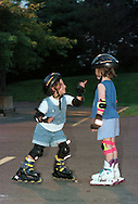 Bi-Weekly, every other Wednesday, rollerblading in the old Jamesway parking lot in New Hope, PA. from 7PM-9PM sponsored by the Solebury Twp., Pa. Parks and Recreation Dept. Jillyan Magerman (CQ), 6, of New Hope, Pa., makes a point to her friend Kaydee Burroughs (CQ), 6, of Lambertville, NJ. while they were rollerblading on Wednesday night in the old Jamesway parking lot off Rt. 202.