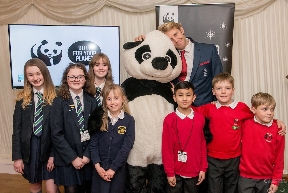 Primary and Secondary School winners  pose with  Andrew Triggs Hodge and Panda during the WWF UK Earth Hour 10th Anniversary Parliamentary Reception, Terrace Pavilion, Palace of Westminster. 28th Feb. 2017