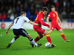 Wales Joe Allen (Liverpool) battles for the ball with Scotland's Darren Fletcher (Manchester United) - Photo mandatory by-line: Joe Meredith/JMP  - Tel: Mobile:07966 386802 12/10/2012 - Wales v Scotland - SPORT - FOOTBALL - World Cup Qualifier -  Cardiff   - Cardiff City Stadium -