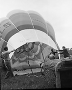 Dew Mighty Minerals Hot Air Balloon.   (H15)..1974..07.08.1974..08.07.1974..7th August 1974..The launching of the Dew Mighty Minerals hot air balloon,took place in Tullamore,Co Offaly last night,as part of the Tullamore Festival Week. The balloon was piloted by Mr Wilf Woollett,a veterinary surgeon from Loughrea,Co Galway and his co-pilot was Kevin Haugh. Miss Rosemary Mannion,the Offaly Rose of Tralee contestant sent the balloon on its way by popping a bottle of Champagne over it.  The balloon itself has a capacity of 56,000 cubic feet,is 60ft high and 50ft wide. It is made from nylon/polyproplene. The basket is 2ft square by 3ft high and carries two people,it is attached to the balloon by steel cables..Wilf Woollett has piloted the balloon in the U.S. and Britain and is a member of the Dublin Balloon Club.
