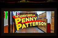 Bellmore, New York, USA. July 18, 2018. Title of comedy sci-fi The Adventures of Penny Patterson, flashes on high school hallway at start of the woman directed film, at LIIFE 2018, the Long Island International Film Expo. The movie, about a high school student facing obstacles to winning science fair when her boyfriend suddenly becomes a superhero, was nominated at LIIFE for Best Student Film, and is screening July 21 at the San Diego Comic-Con International Independent Film Festival, CCI-IFF 2018.