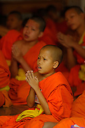 Monks praying at Wat Phra Kaeo Don Tao, Lampang, Thailand