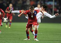Fussball International, Nationalmannschaft   EURO 2012 Play Off, Qualifikation, Tschechische Republik - Montenegro        11.11.2011 Tomas Pekhart (li, Tschechische Republik) gegen Stefan Savic (Montenegro)