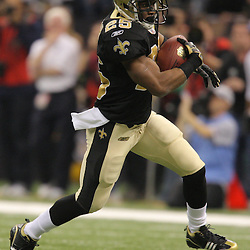 Jan 24, 2010; New Orleans, LA, USA; New Orleans Saints running back Reggie Bush (25) runs with the ball during a 31-28 overtime victory by the New Orleans Saints over the Minnesota Vikings in the 2010 NFC Championship game at the Louisiana Superdome. Mandatory Credit: Derick E. Hingle-US PRESSWIRE