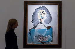 "© Licensed to London News Pictures. 08/04/2016. London, UK. A Sotheby's staff member views Pablo Picasso's ""Mousquetaire"", 1967, est. $5-7million.  Sotheby's auction preview, at their New Bond Street gallery, of works to be in the upcoming New York Impressionist, modern and contemporary art sale. Photo credit : Stephen Chung/LNP"