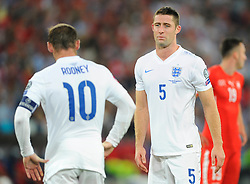 England's Gary Cahill (Chelsea) ® and England captain, Wayne Rooney (Manchester United) (l)  - Photo mandatory by-line: Joe Meredith/JMP - Mobile: 07966 386802 - 08/09/14 - SPORT - FOOTBALL - Switzerland - Basel - St Jacob Park - Switzerland v England - Uefa Euro 2016 Group E Qualifier