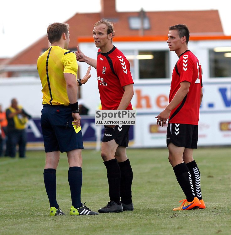 FC Differdange 03's Tom Siebenaler talks his way to a yellow card after protesting about Bala's equaliser in the Bala Town v FC Differdange 03 Europa Cup at Rhyl 09 July 2015<br /> <br /> (c) Colin Paxton / SportPix.org.uk