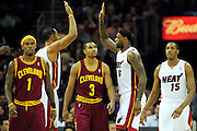 Dec. 2, 2010; Cleveland, OH, USA;  Miami Heat power forward Juwan Howard (5) and Miami Heat small forward LeBron James (6) celebrate after scoring with Cleveland Cavaliers point guard Daniel Gibson (1) and Cleveland Cavaliers point guard Ramon Sessions (3) walk away from the play during the third quarter at Quicken Loans Arena. The Heat beat the Cavaliers 118-90. Mandatory Credit: Jason Miller-US PRESSWIRE