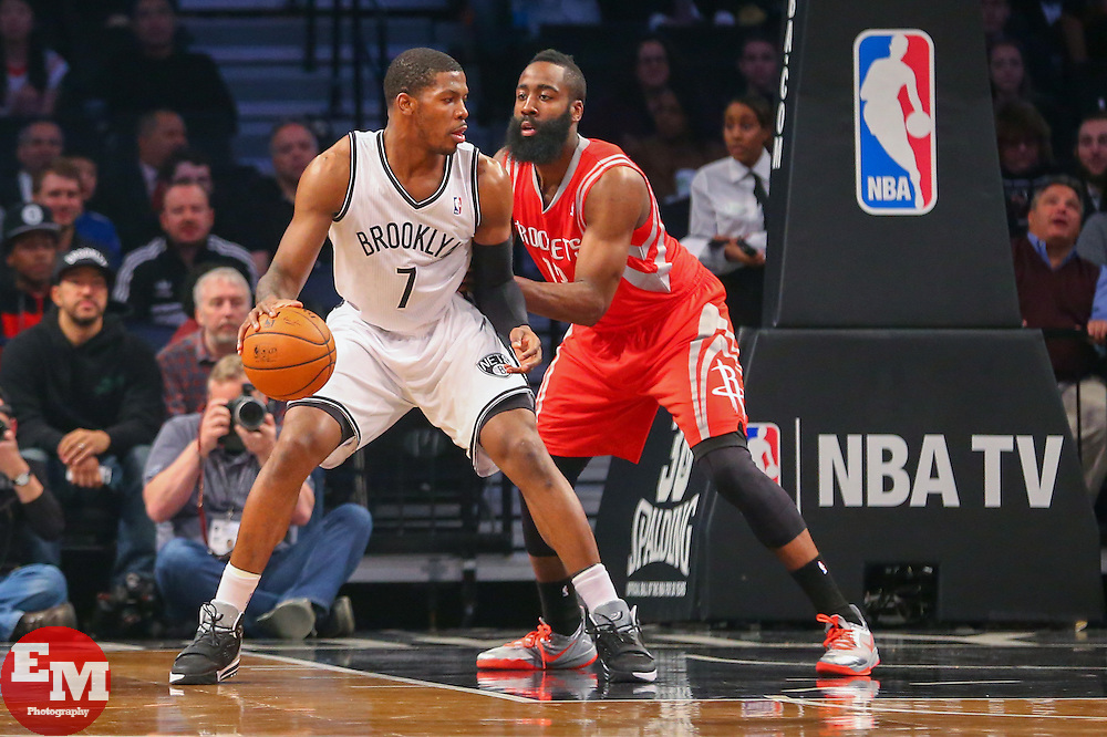 Apr 1, 2014; Brooklyn, NY, USA; Brooklyn Nets guard Joe Johnson (7) dribbles the ball while being defended by Houston Rockets guard James Harden (13) during the first quarter at Barclays Center.