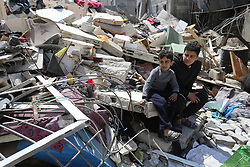 March 28, 2019 - Gaza City, Gaza Strip - Palestinians inspect their house that demolished two days ago by an Israeli airplane, in Gaza city, on March 28, 2019.Palestinian Minister of Public Works and Housing, Mufid al-Hasayneh, said that recent Israeli airstrikes on the besieged Gaza Strip left 30 residential structures completely destroyed, and at least 500 other others partially damaged  (Credit Image: © Ashraf Amra/APA Images via ZUMA Wire)