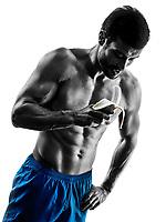 one caucasian man exercising fitness exercises eating Banana in studio silhouette isolated on white background
