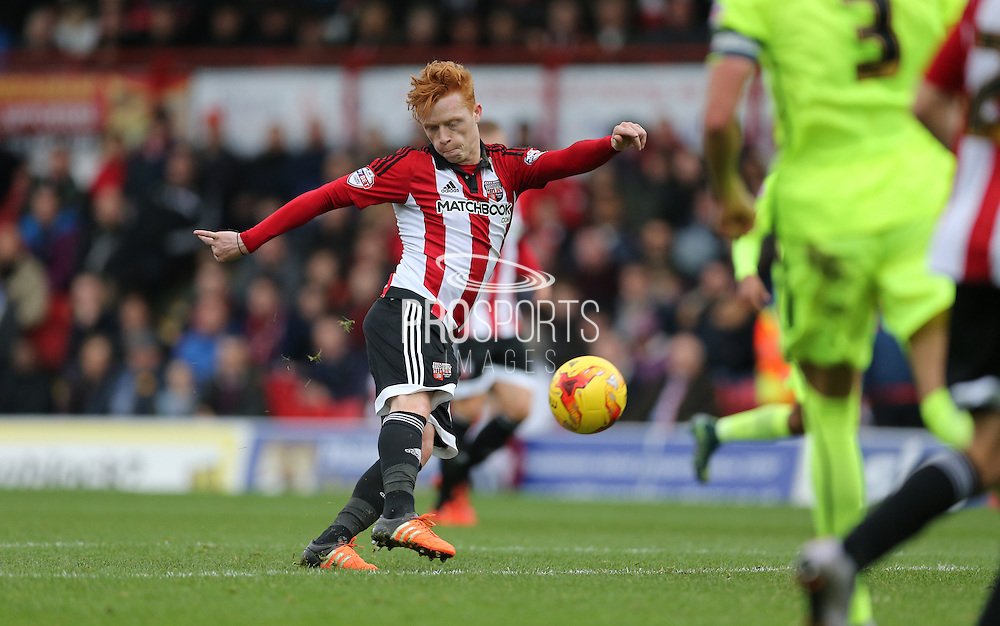 Brentford midfielder Ryan Woods goes close during the Sky Bet Championship match between Brentford and Brighton and Hove Albion at Griffin Park, London, England on 26 December 2015.