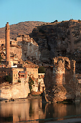 TURKEY HASANKEYF JUL02 - General view of the old settlement of Hasankeyf on the banks of the river Tigris. Its medieval remains of Selcuk, Arabic and Kurdish origin are now threatened by the imminent construction of a dam across the river a little downstream. The dam water will submerge the existing town and lower ruins of Hasankeyf and it is estimated that between 15,000 and 60,000 farmers and villagers will be displaced and lose their livelihood...jre/Photo by Jiri Rezac..© Jiri Rezac 2002..Contact: +44 (0) 7050 110 417.Mobile:  +44 (0) 7801 337 683.Office:  +44 (0) 20 8968 9635..Email:   jiri@jirirezac.com.Web:     www.jirirezac.com