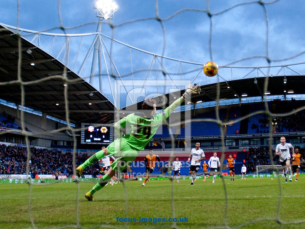 A shot by James Henry of Wolverhampton Wanderers beats Bolton Wanderers goalkeeper Andy Lonergan to make it 2-2 during the Sky Bet Championship match at the Macron Stadium, Bolton<br /> Picture by Russell Hart/Focus Images Ltd 07791 688 420<br /> 31/01/2015